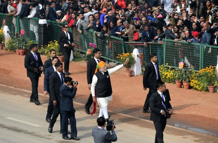 After R-Day Parade, Modi walks down Rajpath to greet people