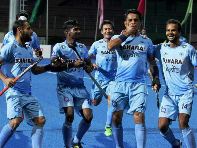 India win to enter summit clash