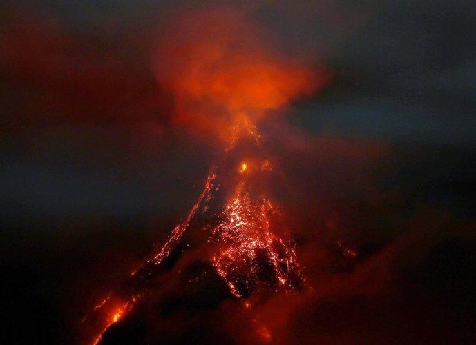 Deadly mudflows threaten residents near erupting Philippine volcano