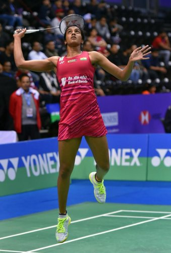 Sindhu fights her way into semis; Saina exits