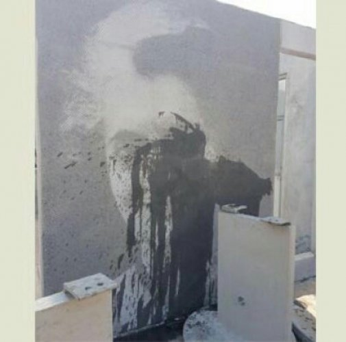 Indira Gandhi's portrait smeared with black ink in Suratkal