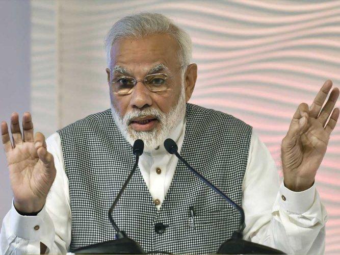 Modi pens book; motivates students to shun exam blues, pursue their passion