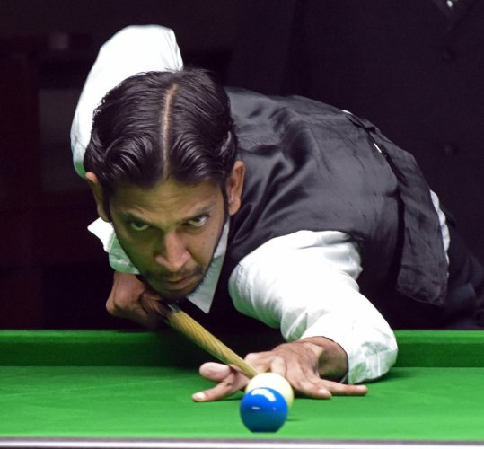 Talwar's cue takes him from pool to snooker