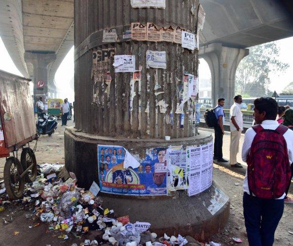 Cheap posters turn metro pillars into an eyesore
