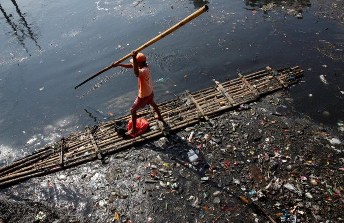 Indonesia president says toxic river should be clean enough to drink