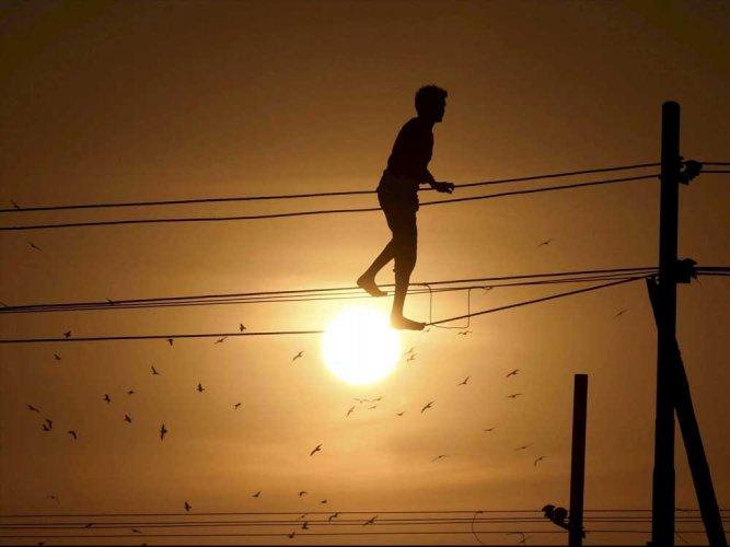 Man climbs overhead power lines, causes flutter