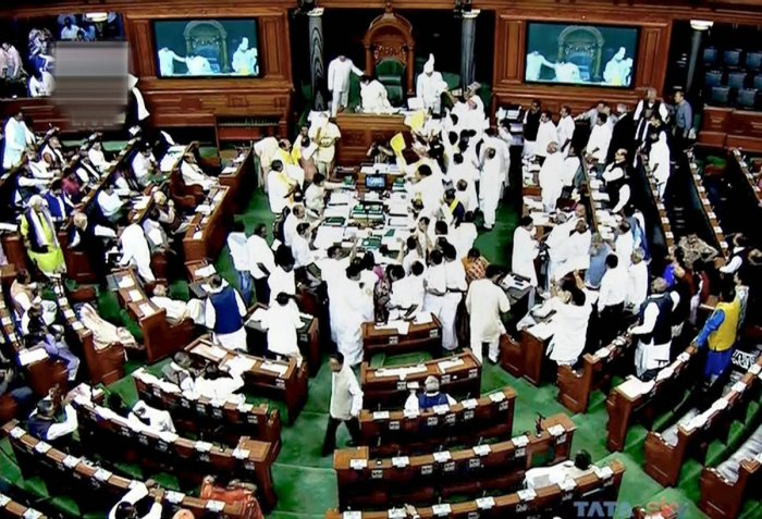Lok Sabha adjourned till noon following Opposition protests