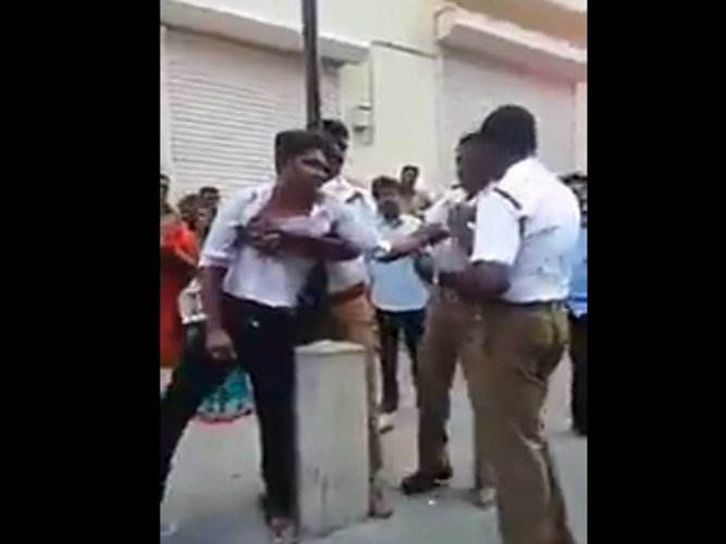 Traffic cops beat up youth after argument on not wearing helmet