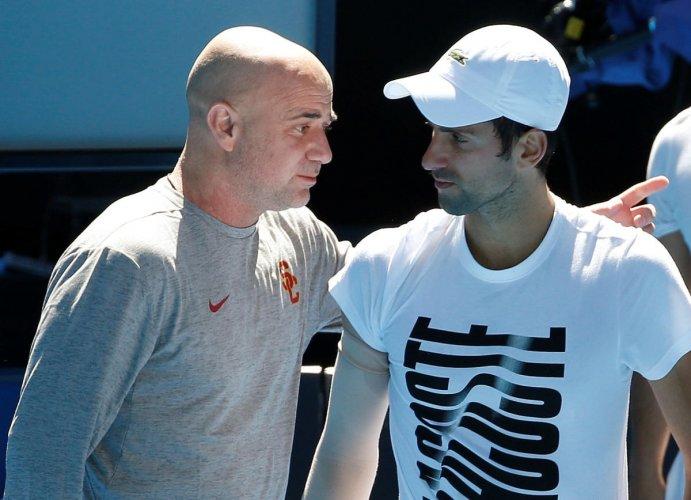 Djokovic splits from Agassi, Stepanek