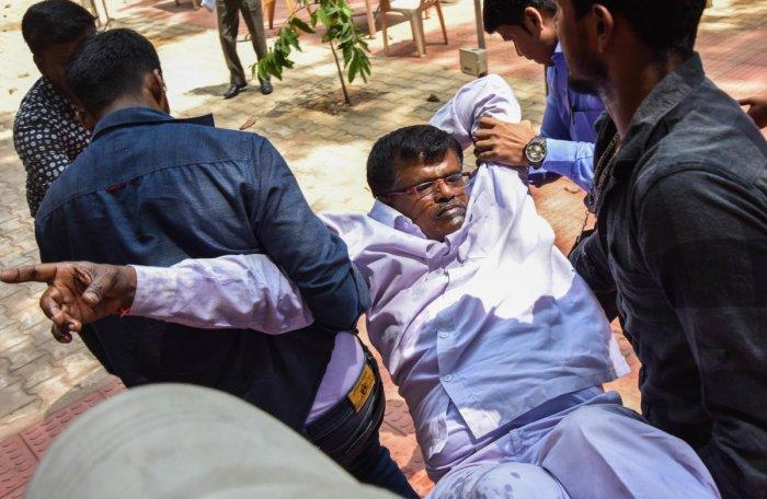 Rowdy Nagaraj drinks 'poison' at press meet