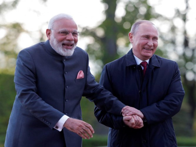 Putin holds phone call with Modi
