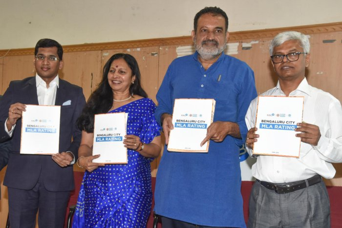 T V Mohandas Pai, Vice President, B PAC, releasing Bengaluru MLA's rating report by B PAC at Press Club in Bengaluru on Friday. Kartik of I Care adviser, Revathy Ashok, Hon Managing Trustee and CEO, N Harish, Adviser B PAC are seen. Photo by S K Dinesh