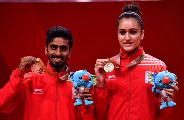 Manika, Sharath claim bronze