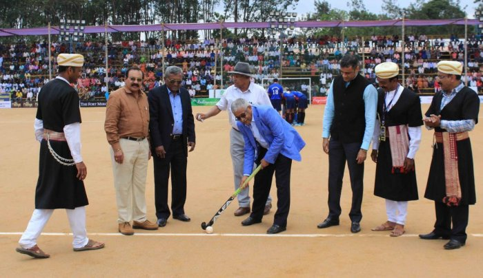Former Indian hockey captain Mollera P Ganesh inaugurates 22nd edition of Kodava Families' Hockey Tournament at General Thimmaiah Stadium at Napoklu on Sunday.