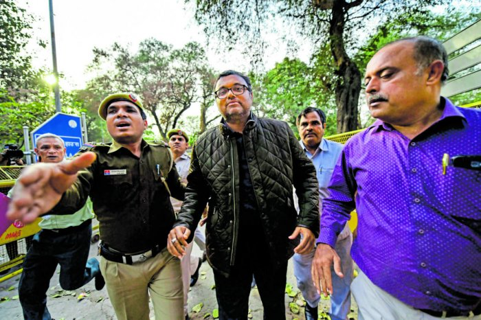Karti Chidambaram, son of former Union minister P Chidambaram escorted by police personnel to the Patiala House court in New Delhi. PTI