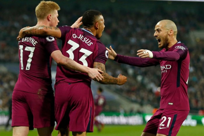 Manchester City's Brazilian striker Gabriel Jesus (C) celebrates with Manchester City's Belgian midfielder Kevin De Bruyne (L) and Manchester City's Spanish midfielder David Silva (R) after scoring the opening goal of the English Premier League football m