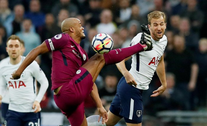 Manchester City's Vincent Kompany in action with Tottenham's Harry Kane REUTERS.