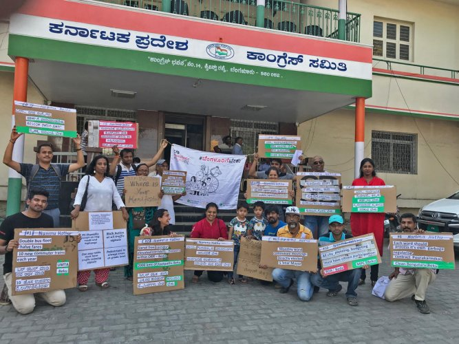 Volunteers of the Citizens for Bengaluru (CfB) hold a flash mob protest outside the Congress office on Sunday.