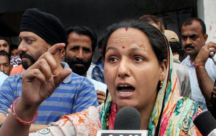 Madhu Sharma, daughter of the main accused in Kathua rape and murder case Sanji Ram, talks to the media demand to demand a CBI probe in the case, on Monday. PTI