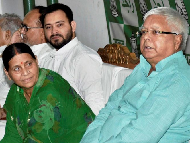 Former Bihar chief minister and Lalu Prasad's wife Rabri Devi, and their son Tejashwi were also among the 14 people named by the CBI in the chargesheet file in a court here. AP/PTI File Photo