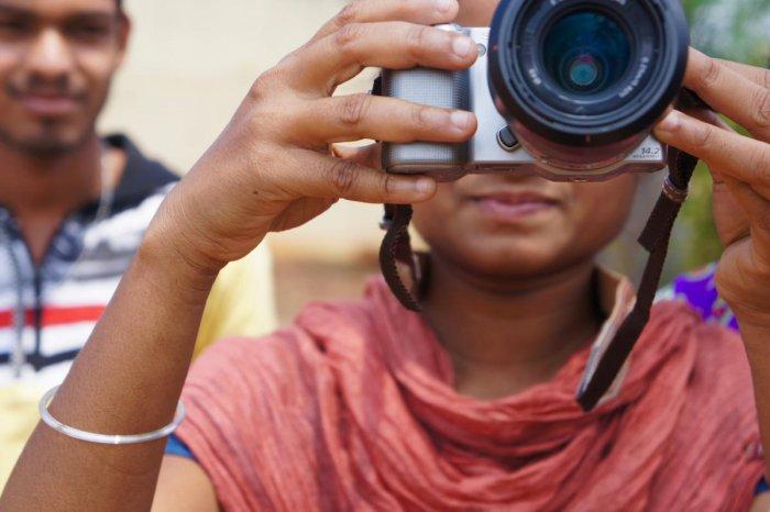 A participant taking photos