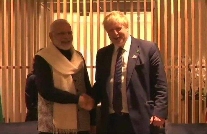 In picture: Prime Minister Narendra Modi and UK Foreign Secretary Boris Johnson. ANI Photo.