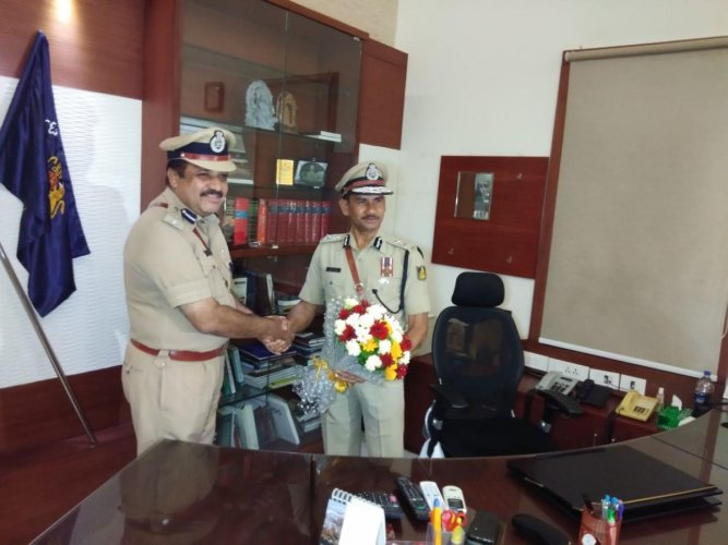 Vipul Kumar takes charge as the new Commissioner of Police from outgoing Commissioner T R Suresh on Wednesday night.