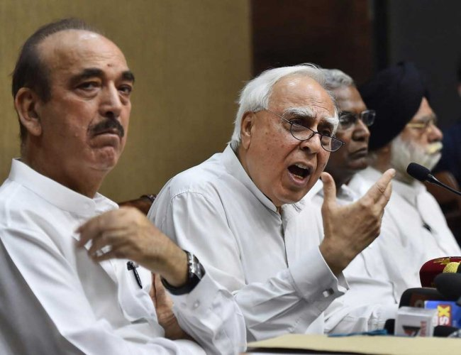 Congress leader Kapil Sibal addresses a press conference after opposition parties submitted a notice to the Vice President and Rajya Sabha Chairperson Venkaiah Naidu to initiate impeachment proceedings against Chief Justice of India Dipak Misra, in New Delhi on Friday. Congress leader Ghulam Nabi Azad, CPI leader D Raja and Rajya Sabha MP KTS Tulsi are also seen. PTI Photo