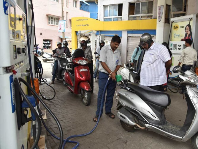 The hike necessitated due to firming international oil prices, comes on back of a 13 paisa increase in rates of petrol effected yesterday and a 15 paisa hike in diesel. DH photo