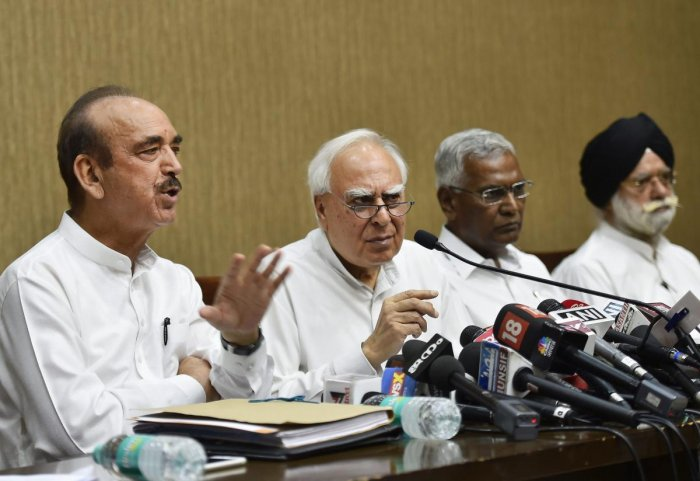 Congress leaders Ghulam Nabi Azad, Kapil Sibal, CPI's D Raja and KTS Tulsi address a press conference after opposition parties submitted a notice to the Vice President and Rajya Sabha Chairperson Venkaiah Naidu to initiate impeachment proceedings against Chief Justice of India Dipak Misra, in New Delhi on Friday. PTI Photo