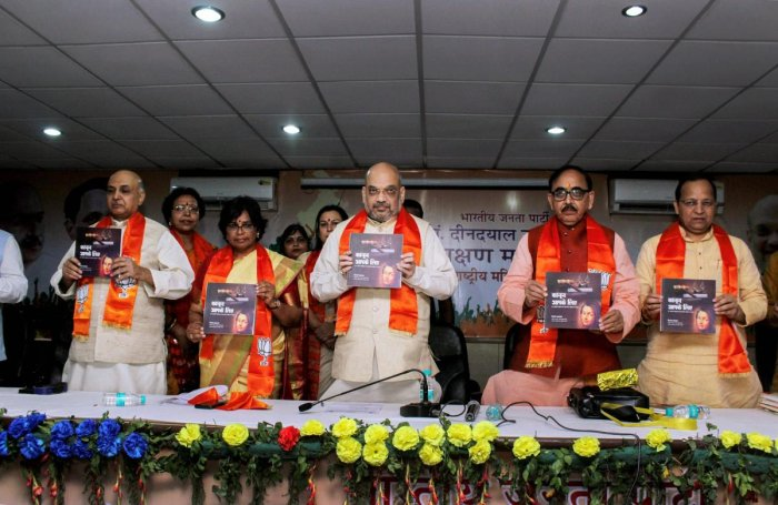 BJP National President Amit Shah releases a book during 'Deendayal Upadhyaya Prashikshan Mahabhiyan' event in Ghaziabad on Sunday. PTI Photo