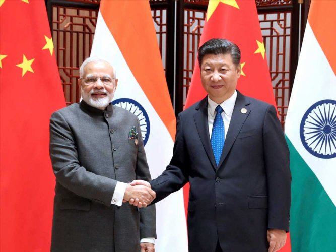 Prime Minister Narendra Modi and Chinese president Xi Jinping are likely to discuss a set of new measures to avert flashpoints along the disputed India-China boundary. (PTI file photo)