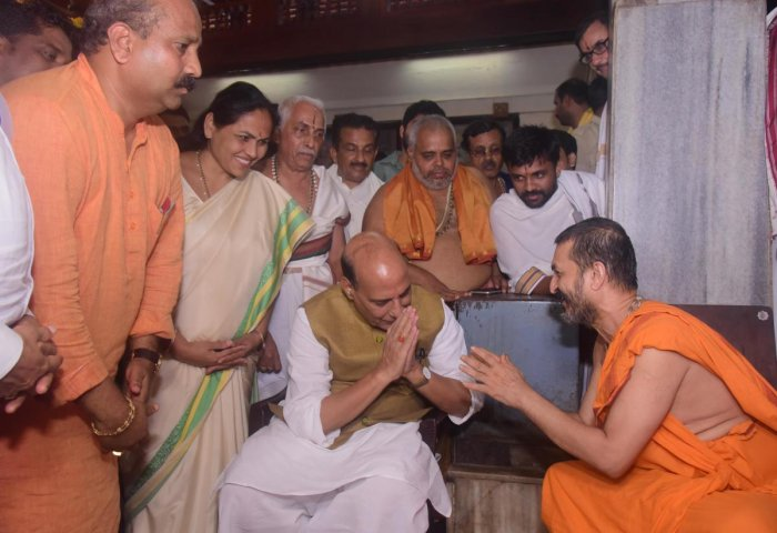 Union Home Minister Rajnath Singh greet Paryaya Palimar Mutt Seer Vidyadheesha Thirtha Swami in Udupi on Monday. The minister visited Udupi Krishna Temple and had the darshan of presiding deity.