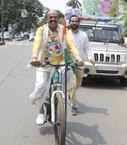 with pics7MLA and Congress candidate from Mangaluru City North constituency Mohiuddin Bava arrives in bicycle for filing the nomination papers, in Mangaluru on Monday.