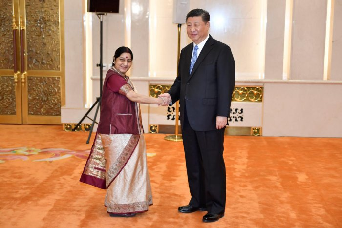 Indian Foreign Minister Sushma Swaraj shakes hands with Chinese President Xi Jinping before a meeting at the Great Hall of the People in Beijing, China April 23, 2018. (Naohiko Hatta/Pool via REUTERS)
