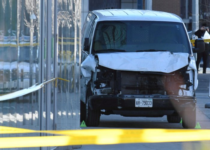 A damaged van seized by police is seen after multiple people were struck at a major intersection northern Toronto, Ontario, Canada, April 23, 2018.