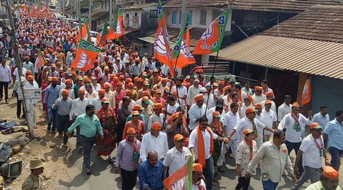 BJP workers took out a procession before candidate K G Bopaiah filed his nomination papers in Virajpet on Tuesday.