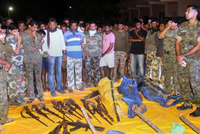 Security personnel show the guns recovered from the Naxals killed in an encounter at Broriya forest area in Bhamragad taluka of Gadchiroli district of Maharashtra. PTI File Photo