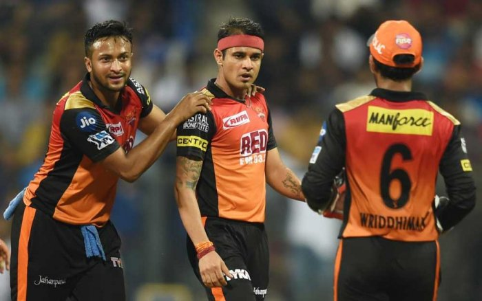 Sunrisers Hydrabad bowler Siddharth Kaul celebrates the wicket of Mumbai Indans batsman Mitchell Mcclenaghan during the IPL match played in Mumbai on Tuesday. PTI Photo