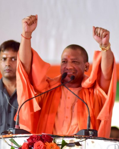 Uttar Pradesh Chief Minister Yogi Adithyanath addressing at the public meeting, as a part of parivarthana yatra, at Vijayanagar in Bengaluru on Sunday. Photo/ BH Shivakumar