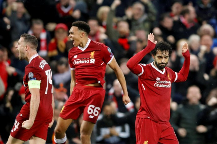 Liverpool's Mohamed Salah celebrates scoring their first goal with teammates in the first leg of the Champions League semi-final. Reuters.