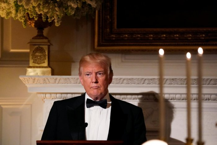 U.S. President Donald Trump toasts French President Emmanuel Macron (not pictured) during a State Dinner at the White House in Washington, U.S. April 24, 2018.