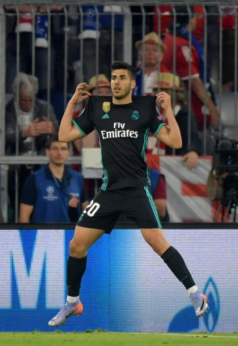CRUCIAL STRIKE Real Madrid's Marco Asensio celebrates scoring their second goal against Bayern Munich on Wednesday. REUTERS