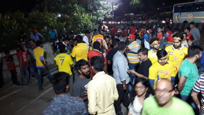 The man in black t-shirt was among the many openly selling tickets in black at the Chinnaswamy Stadium on Wednesday.DH PHOTO SRIKANTA SHARMA R