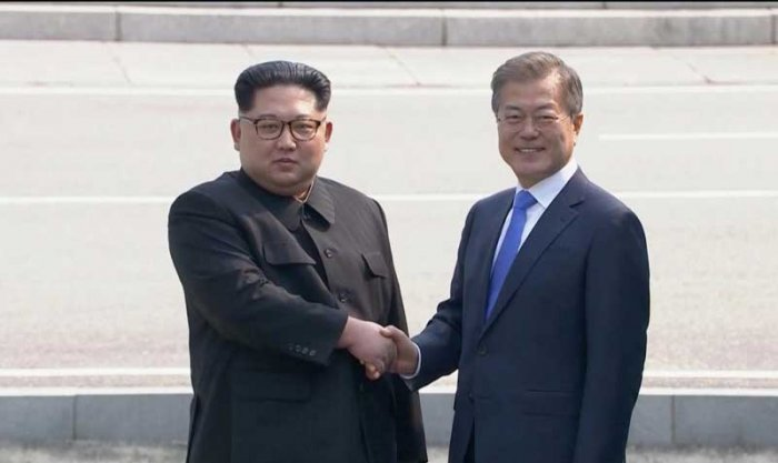 North Korean leader Kim Jong Un shakes hands with South Korean President Moon Jae-in as both of them arrive for the inter-Korean summit at the truce village of Panmunjom, in this still frame taken from video, South Korea April 27, 2018.