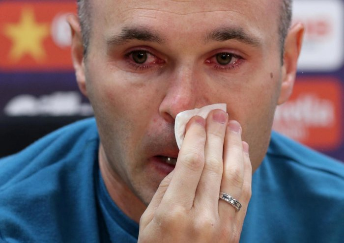 GOODBYE LEGEND Andres Iniesta breaks down during a press conference on Friday where he announced he'll be leaving Barcelona at the end of the season. REUTERS