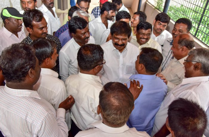 Nelamangala constituency Congress Candidate R Narayana Swamy discursion with his supporters, at his residence, Nelamangala, Rural Bengaluru on Thursday. Photo/ B H Shivakumar ,