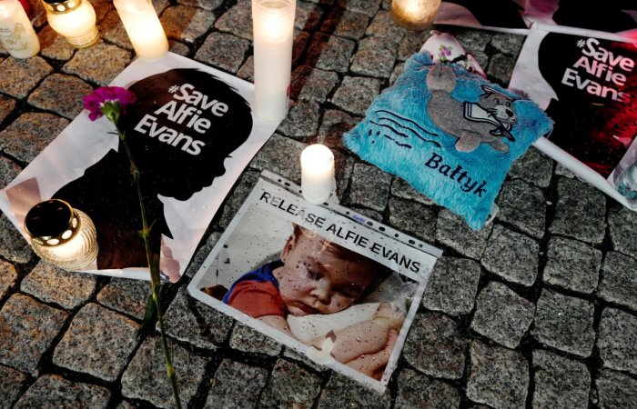 Candles and placards are pictured during a protest in support of Alfie Evans, in front of the British Embassy building in Warsaw, Poland. Reuters Photo