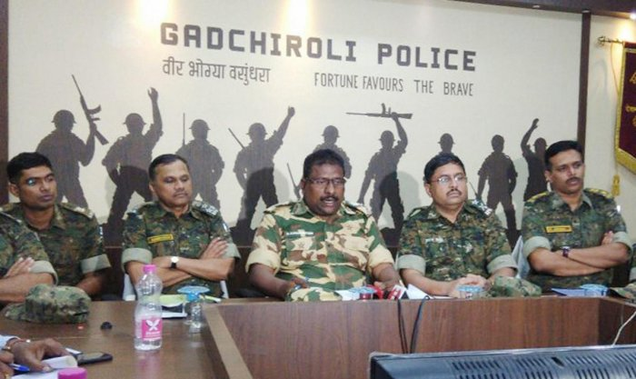 Addl. Director General of Police (Special Operations) Maharashtra State, D Kanakratnam (C) and other top officials addresses the press conference regarding an encounter earlier with 37 Naxels at Gadchiroli of Maharashtra on Tuesday. PTI Photo