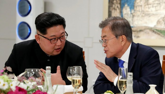 South Korean President Moon Jae-in and North Korean leader Kim Jong Un attend a banquet on the Peace House at the truce village of Panmunjom inside the demilitarized zone separating the two Koreas, South Korea, April 27, 2018. Reuters